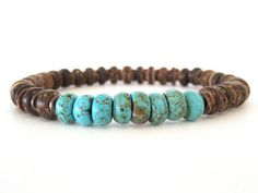Masculine beaded stretch bracelet for men featuring 8x3 brown coco pukalet beads, 8mm turquoise magnesite rondelle beads and antiqued copper wavy spacer beads. The coco beads come from the Philippine tropical islands where coconut trees grow in abundance and easily sourced across-seasons. The coco beads contrast well with the copper beads.