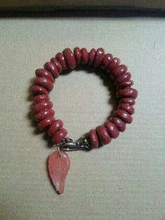 Check out this item in my Etsy shop https://www.etsy.com/uk/listing/272406546/clay-bead-and-red-cherry-quartz-angel