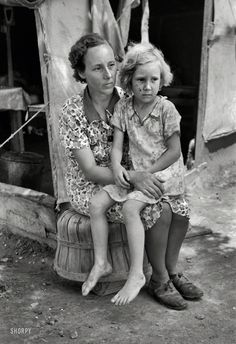 "Working Mom: June 1939. ""Mother and child, agricultural day laborer family encamped near Spiro. Sequoyah County, Oklahoma."" Photo by Russell Lee."
