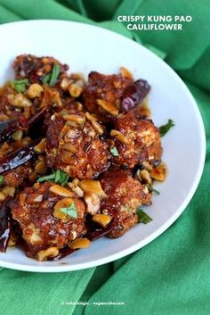 Crispy Kung Pao Cauliflower. Cauliflower battered and baked and tossed in spicy kung pao sauce. Appetizer for gameday. Vegan Recipe. Can be gluten-free.