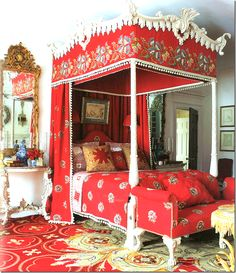 Carolyne Roehm red bedroom. The bed is an exact copy of an antique.