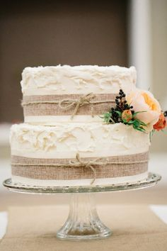 burlap-wrapped wedding cake // photo by Lora Grady.... Bigger cake and would match the burlap wine bottle center pieces