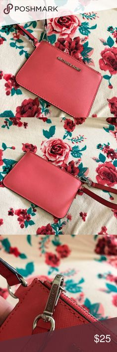 Michael Kors coral wristlet Super cute Michael Kors wristlet in great condition. No damage inside or out. Can fit a few credit cards. Will not fit a cell phone. KORS Michael Kors Bags Clutches & Wristlets