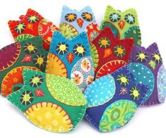 Colorful owl Christmas ornaments, handmade from felt and cotton prints with hand embroidered details. Each owl is 8cm high and has a cotton loop for hanging. The owl ornaments come in a set of 3, in v                                                                                                                                                     More