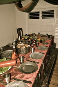 Medieval Feast table.  To Make these dishes, I just spray painted the outside of clear glass dishes-turned out amazing