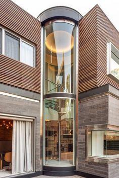 Annex Residence, Glass spiral stair, Honed Eramosa limestone, ipe wood cladding, zinc fascias and stainless steel, Toronto Architecture, Custom Homes