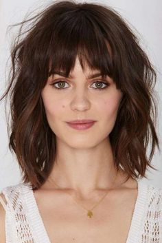 Mid-Length Cut With Bangs ringe Haircuts are an excellent way to get thick heavy hair out of your eyes so you can flaunt your gorgeous face. You can chose to rock side bangs or opt for short, straight bangs. For those with chubby cheeks or a rounder face, a long side bang is most flattering, while shorter, blunt bangs work best on those with bigger foreheads or oval faces.