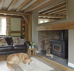 Border Oak - Making sure your pets feel just as much at home as you do! Living Pequeños, Cottage Living Rooms, Home Living Room, Living Room Decor, Wood Stove Decor, Inglenook Fireplace, Fireplaces, Oak Beam Fireplace, Border Oak