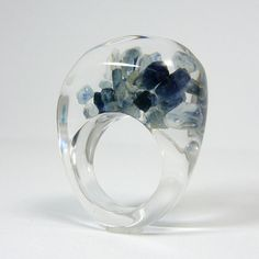 8cts of rough Montana sapphires, beautifully trapped in clear resin