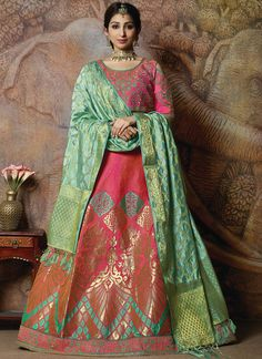 Dual Tone Pink Weaved Jacquard Silk Embroidered Lehenga Description: Fabric of this lehenga is weaved jacquard silk. Comes along with a golden brocade choli and rani pink weaved silk dupatta. Lehenga choli is semi stitch. Lehenga choli has thread and Indian Bridal Lehenga, Bridal Lehenga Choli, Green Silk, Pink Silk, Green Fabric, Lehenga Indien, Dupatta Setting, Stone Work Blouse, Silk Dupatta