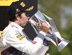 Sergio Perez celebrates on the podium. #canada2012