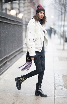 Pictured here in New York, take inspiration from French Victoria's Secret model Cindy Bruna and beat the elements in style. Photo: Timur Emek