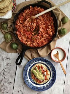 How to make tinga poblana, a Mexican dish with a tomato base and shredded chicken. Great for tostadas, tacos, served with rice, or as a quesadilla! This dish is also sometimes known as tinga de pollo or chicken tinga. Recipe on theothersideofthetortilla.com.
