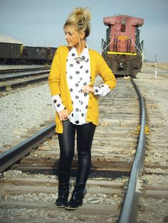 polka dot shirt, cardigan, black pants, black boots, statement necklace