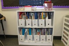 White on white for storage totes and shelves is a good choice for organizing paper, book, and notebook collections of random sizes.