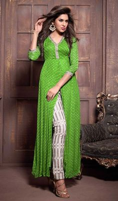 Be the center of attention by sporting this green shade chiffon pant style suit. Beautified with stones work all synchronized properly with all pattern and style of the attire. #FashionablePartyWearDress