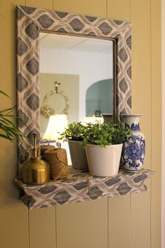 Frame a plain Jane mirror using fabric & Mod Podge.
