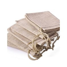 The non woven wedding favor pouches can be filled with a special treat for a rustic, shabby style reception.