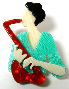 The Lea Stein saxophone player brooch - photographed by Gillian Horsup