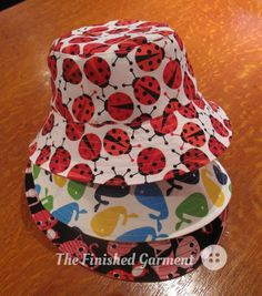 A pile of bucket hats sewn by The Finished Garment using the Bucket Hat sewing pattern from Oliver + S.