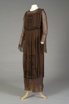 Brown silk georgette dress with black and coral beading, American, ca. 1918, KSUM 1987.70.1 ab.