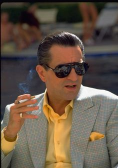 The only good things are his acting and the yellow in the jacket used for the shirt/pocket square.