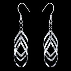 Silver earrings, ovals Silver earrings, AG 925/1000. Rhodium finished. Dangles consists of three ovals which are connected with links. During the movement the earrings are freely moving and creating interesting 3D effect. Dimensions approx. 20x40mm including enclosure. Price per pair.