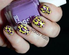 Lydia's Nails: Leopard print mani using Essie Play Date, Revlon Grape and Sally Hansen Mellow Yellow as a base. I can sense a copy-mani on the horizon. :)