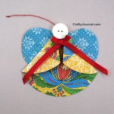 Folded Paper Angel Ornament | This little angel craft is made by folding a circle of scrapbook paper. So cute!