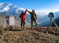 John Galetzka, then of Caltech, and Sudhir Rajaure, of the Department of Mines and Geology in Kathmandu, install a high-rate GPS station in the Himalaya. Credit: John Galetzka