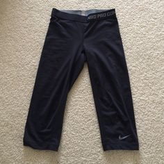 Nike Pro Combat Crop Leggings Plain black workout leggings to go with anything. Comes to just below the knee Nike Pants Leggings