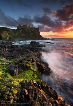 """Medieval Dusk"" Dunluce Castle is a now-ruined medieval castle in Northern Ireland."
