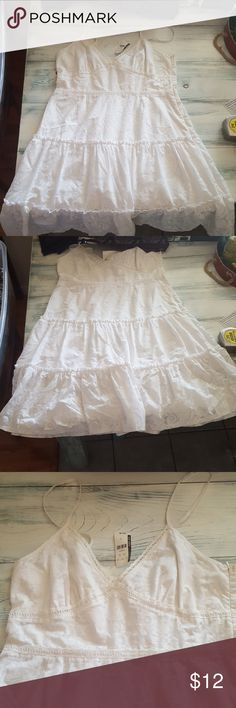 Women's beautiful Sun dress New York and Co women's white lace eyelet sun dress.  New with tags. Bought for my daughter and she never wore New York & Company Dresses Midi