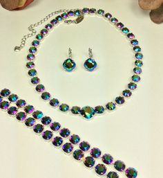 Brand New Swarovski Color for Fall - Scarabaeus Green - but dont think this is just any Green. This is a gorgeous Multi- Hued Crystal. There is