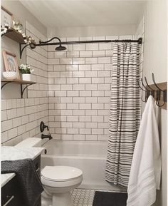 bathroom makeover (3 days!) - We spent less than 2k and we basically demoed it to the studs. The new vanity with the marble top, floor tile, oversized subway tile, and bronze fixtures are from @loweshomeimprovement. The shower curtain, accessories, and indigo towel and rug are from @target. The shelf brackets are from @worldmarket ...
