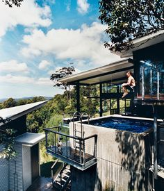 Resident Stephen Dunlop launches into the concrete plunge pool on the first floor of his home in Noosa, Australia. Photo by Richard Powers.