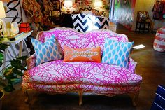 i love the colors and could see recreating this with a thrift store find.  it looks a bit like someone took a pink crayon to the sofa and i love that!