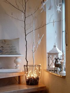 Love the branches in the wire basket with pine cones and fairy lights!