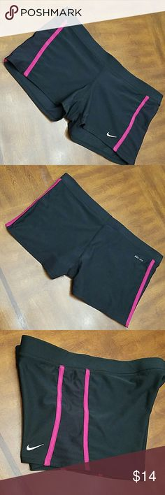 """EUC Nike Dry Fit Athletic Shorts Black and hot pink with mesh accents on the sides. Elastic waistband, hidden inside pocket. Laying flat the waistline across the top hem measures 17"""". Length 10.5"""", inseam 2.75"""". Like new condition. Bundle with any other Nike item and get 2 for $20. Use offer button.  😉 (Nike only). Nike Shorts"""