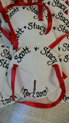 Our personalized Calligraphy Sand Dollar Ornaments. They make a perfect Beach Wedding favor!