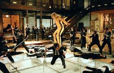 """Uma Thurman (in the yellow jumpsuit), portrays """"Beatrix Kiddo"""" and her handiwork, as she continues the slaughter of the """"Crazy 88"""", in the film """"Kill Bill"""" The Crazy 88 are just a few of the antagonists in this film"""