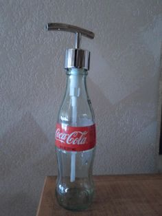CocaCola Liquid Soap Dispenser Coke Lotion by SchulersGlassDecor Coca Cola Bottles, Soap Dispensers, Liquid Soap, Coke, Spray Bottle, Cleaning Supplies, Lotion, I Shop, Handmade