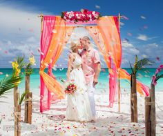 Bright tropical theme using juicy colors of fuchsia, orange, green and yellow in the decor of your destination beach wedding in Punta Cana.