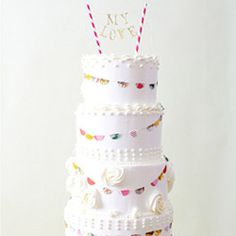 A round up of the prettiest and most unique cake toppers to give your wedding cake some va va voom!