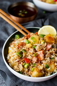 Hawaiian Fried Rice with Easy Sweet and Sour Sauce - Fried rice with pineapple may sound strange, but after you try this recipe, you'll see that it just works! It's made with big chunks of ham and pineapple, veggies and an addicting sweet and sour sauce.