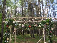 garland and arch detail. Maine woodland wedding.