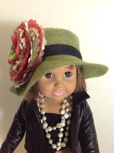 Emily is not sure where to go with this hat. The flower is made of paper so maybe she just needs to make an umbrella first.  SOLD.