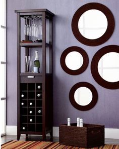 mirrors on wall   Use mirrors to expand a small space. Place a large wall mirror in a small guest room to open it up or group several mirrors down a dark, short or narrow hallway
