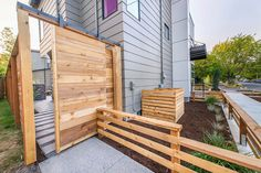 Modern Urban Landscape characterized by clean simplicity, designed by Paradise Restored Landscaping & Exterior Design of Portland, Oregon - gate and fence