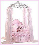 The Hollywood Junior Bed is a round toddler-sized bed complete with a double-laminated, waterproof, high-density foam mattress,a quilted pink mattress platform with tassels, and a matching quilted pink headboard. Add the Princess Frette Jr. Bed Frame,a hand-forged dome of ornate ironwork, and you will set your daughter's room apart from any other!   http://girlsthemebedrooms.com/princess/cinderella-fairytale-decorating-ideas.html